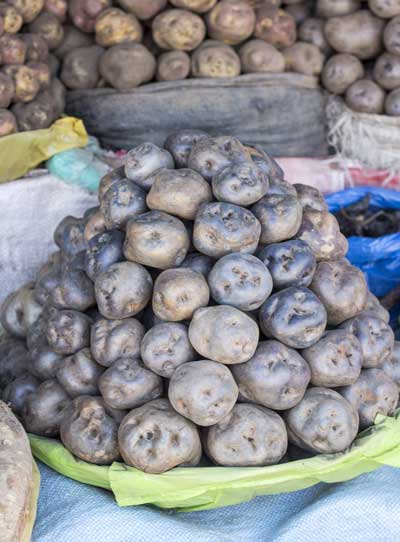 purple potatoes in peru marketplace