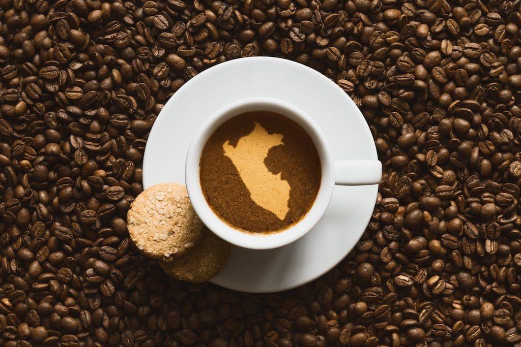 hot Peruvian coffee beverage with map of Peru