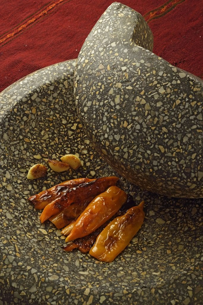 red peppers chilis on batan pestle and mortar