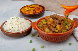 seco de carne with fried plantain and rice