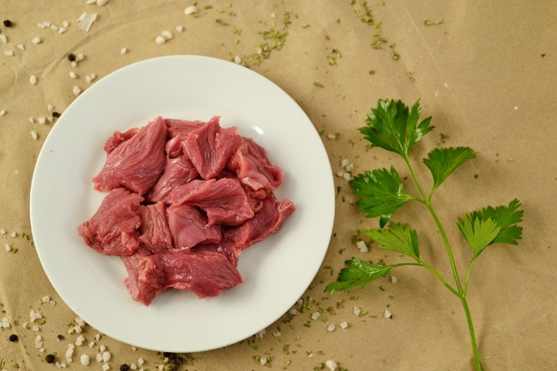Raw strips of sirloin steak