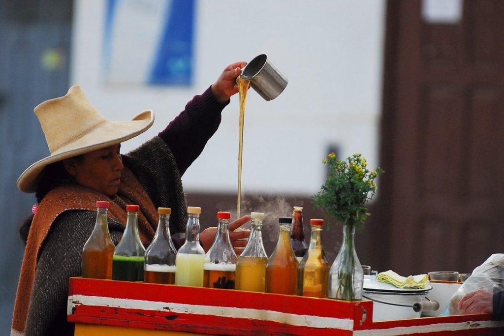 Street seller preparing emoliente