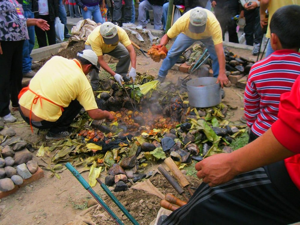 Pachamanca baking with hot stones in the ground
