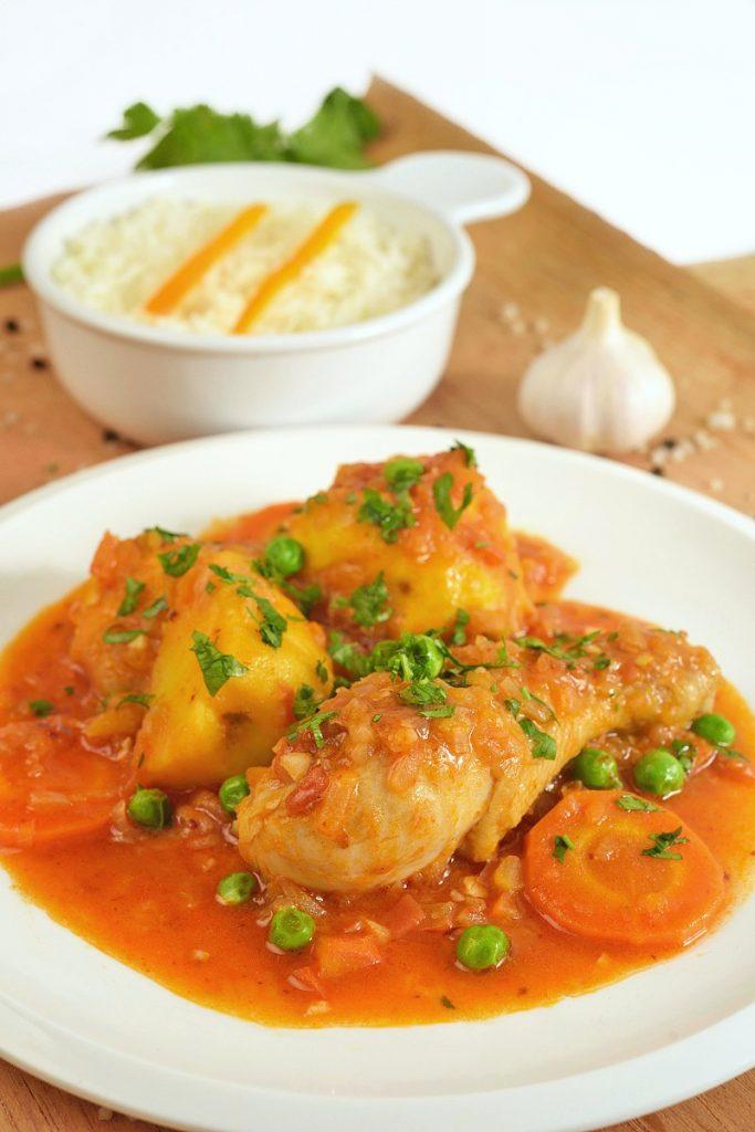 plate of estofado chicken stew peruvian recipe