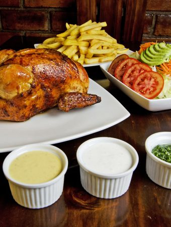 Pollo a la Brasa with salad and dipping sauces