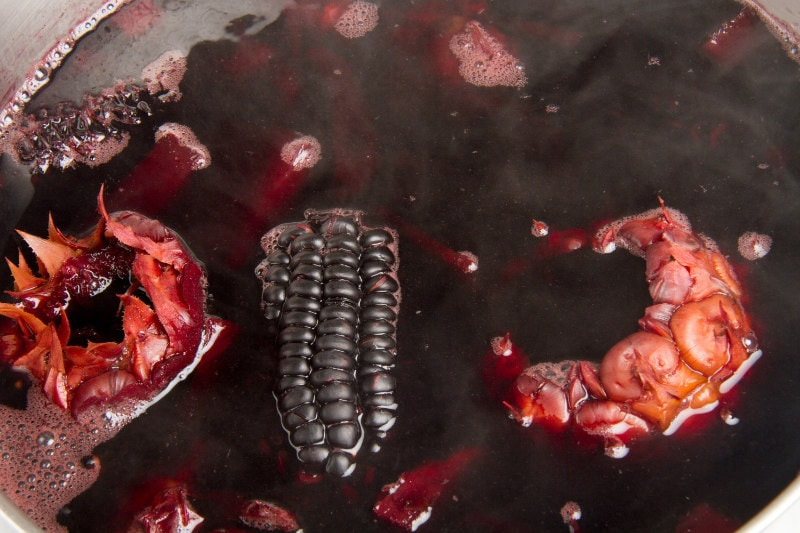 purple corn and pineapple boiling in pot