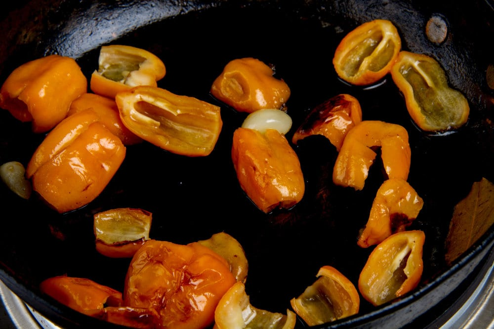Frying yellow peppers in pan