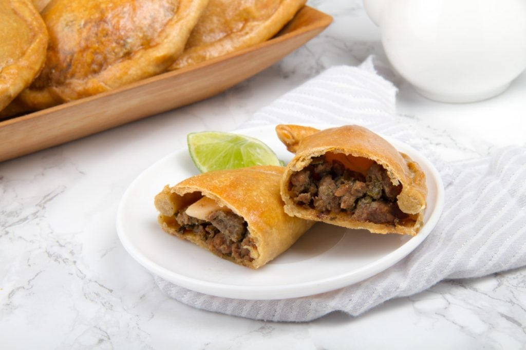 close up of baked beef empanada