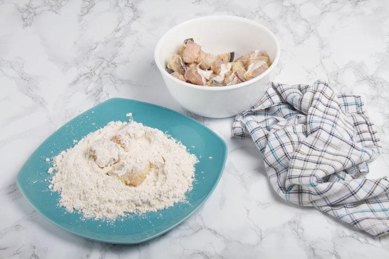 dip the fish in cornstarch or flour