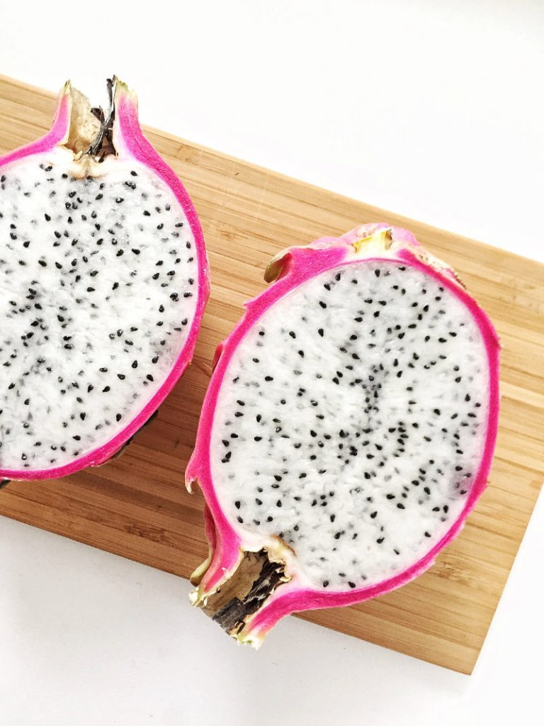 pitaya chopped in half with seeds
