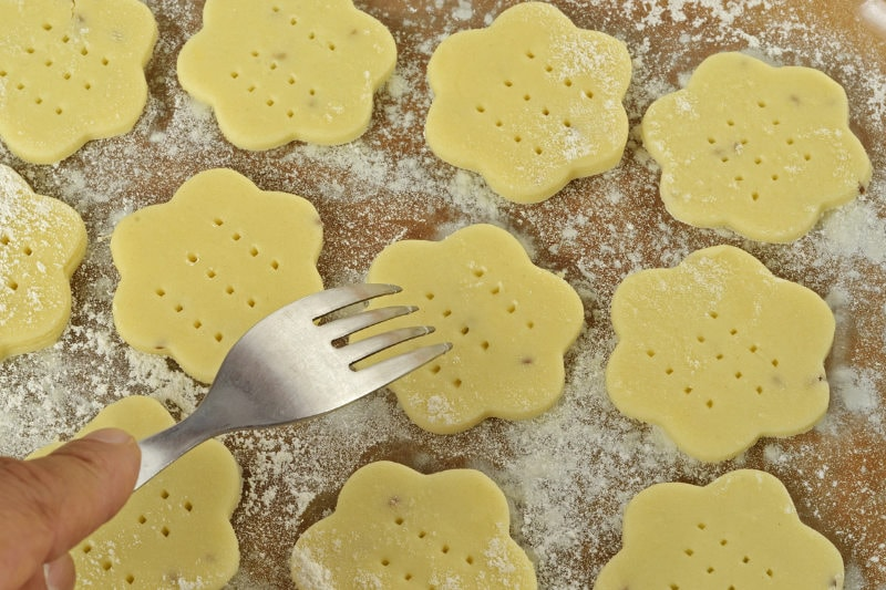 punch holes in cookie dough with fork