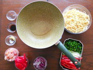 step 1 ingredients for tallarin saltado recipe - heat oil in pan