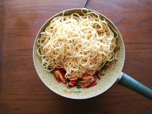 step 7 add cooked egg noodle and stir