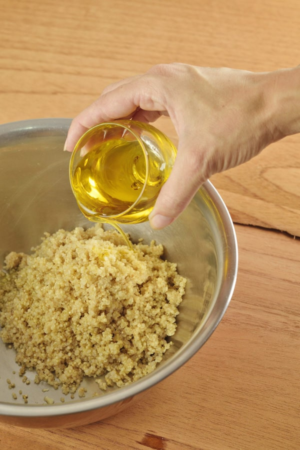 add olive oil to quinoa in large bowl and mix
