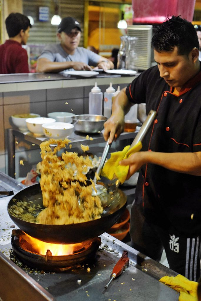 Peruvian Chinese chifa chef at work in Lima, Peru