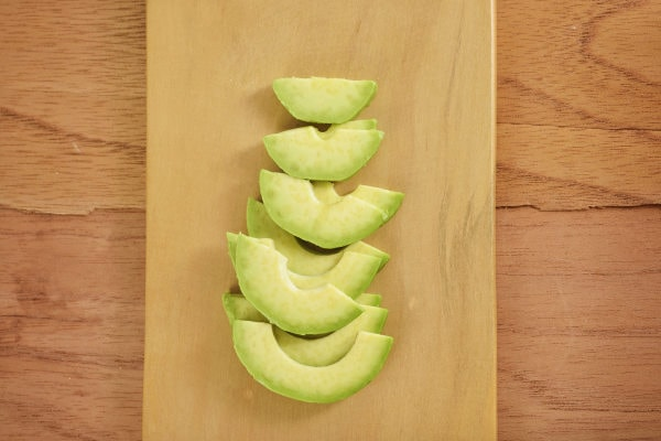 remove avocado flesh and cut into thin slices