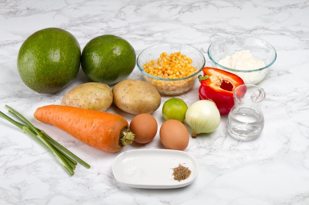 vegetarian stuffed avocado ingredients on table top