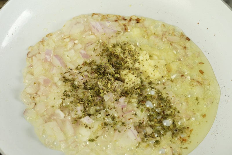 oregano added to garlic and onion