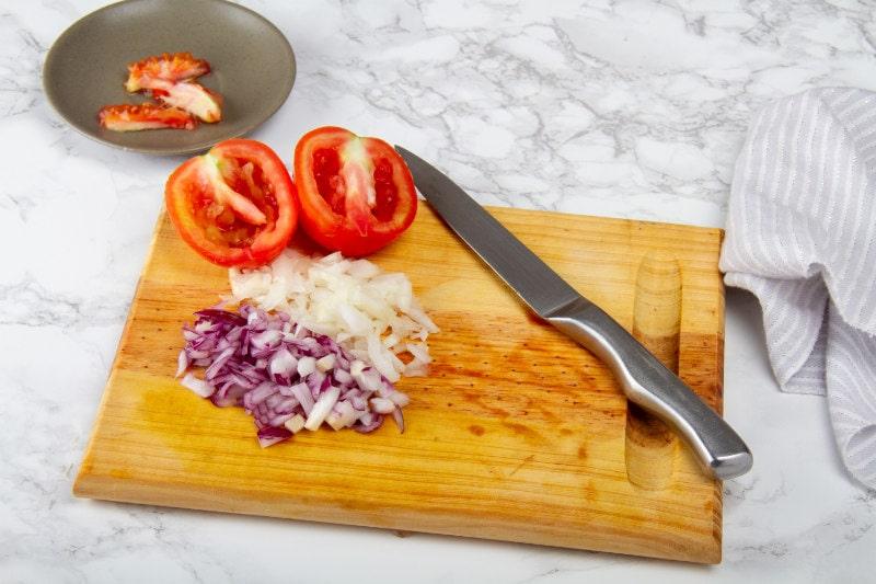 chop tomatoes onion