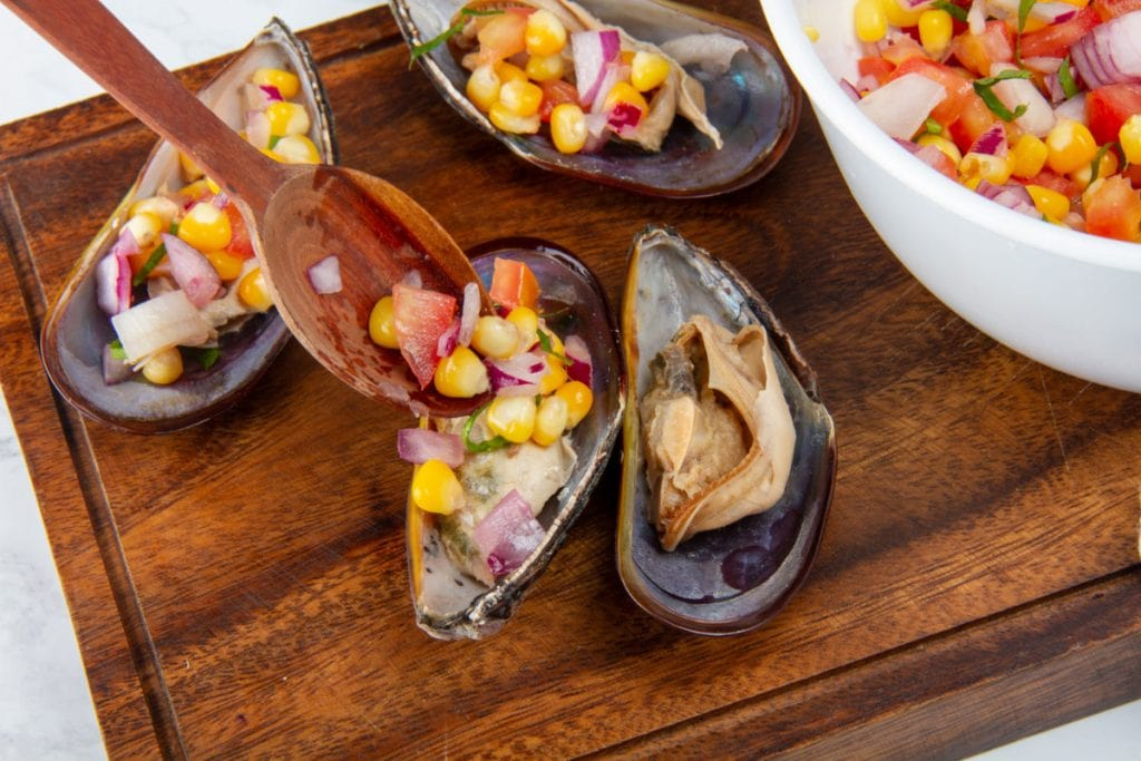 close up of mussel with corn onion and culantro