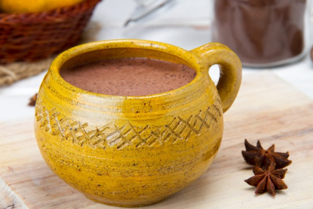 Close Up Of Milky Dark Hot Chocolate Drink With Star Anise
