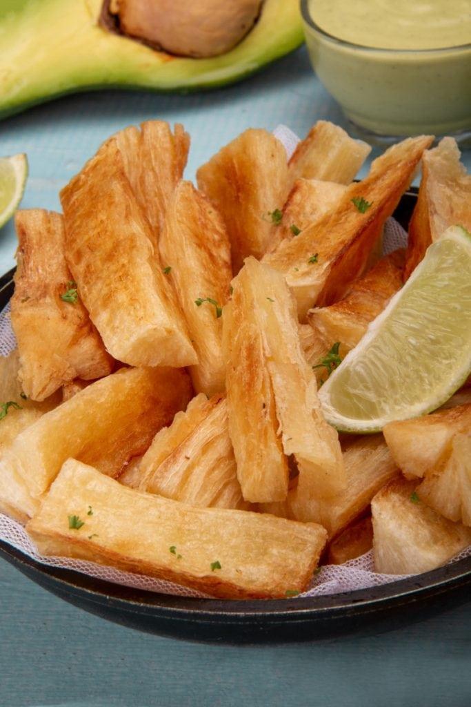 Yuquitas Fritas With Lime Garnish