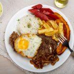 Delicious Rich Lomo A Lo Pobre Peruvian Steak Dish