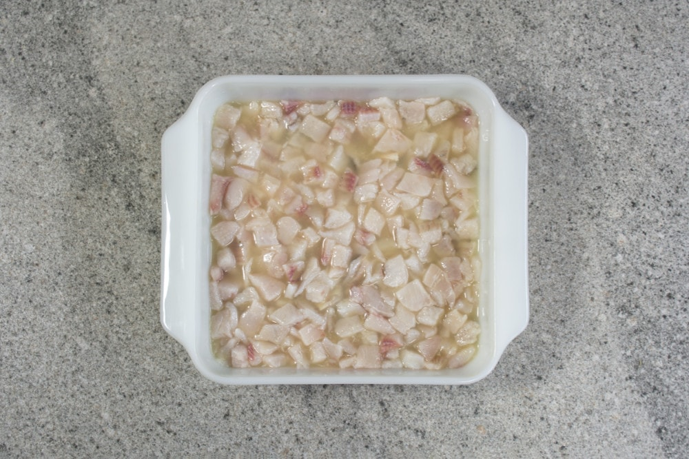 Tilapia Marinating In Lime Juice
