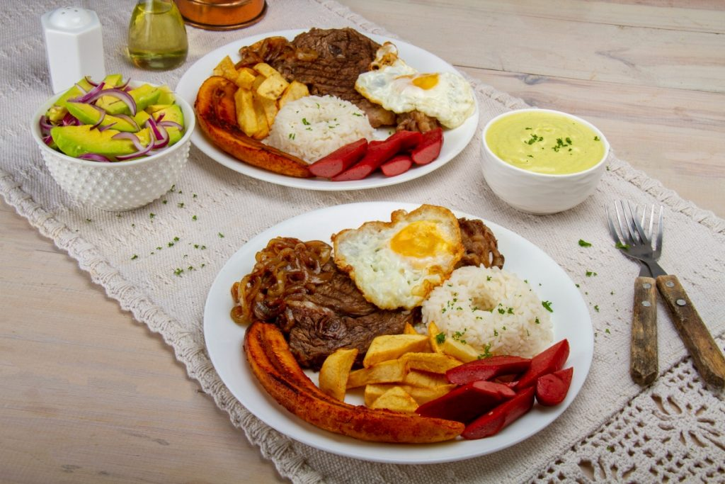 Two Plates Of Peruvian Poor Mans Steak And Egg Dish