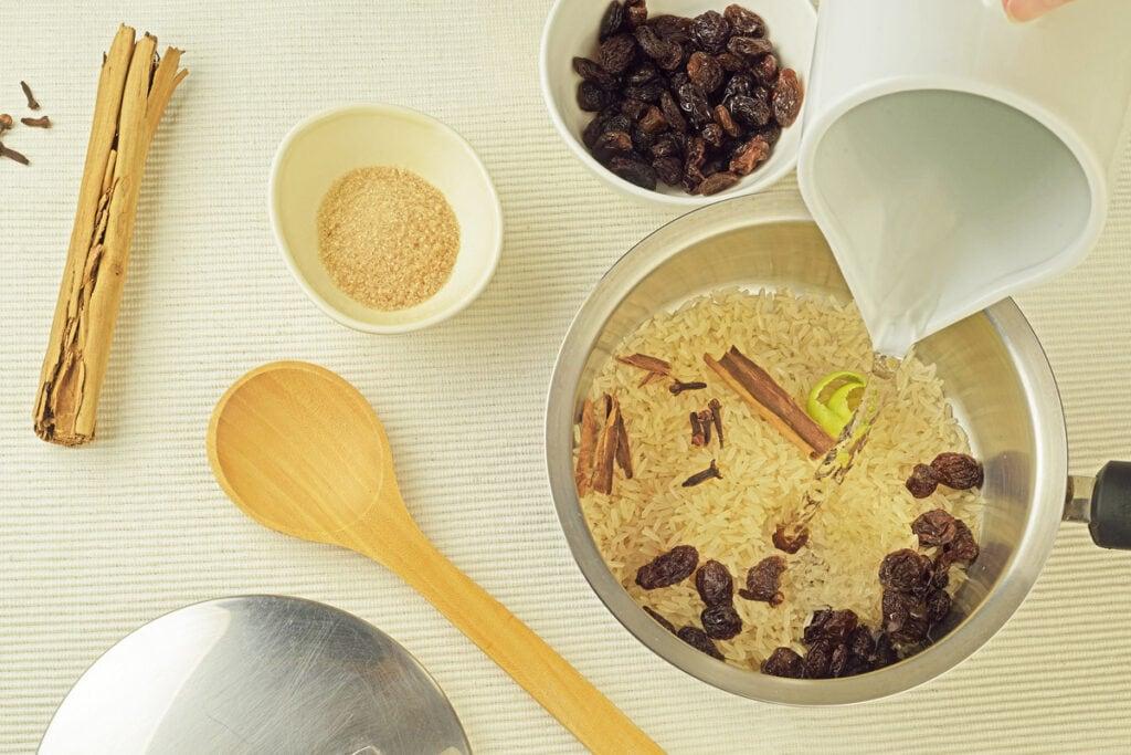Step 1 Add Rice Cinnamon Stick Raisins Water