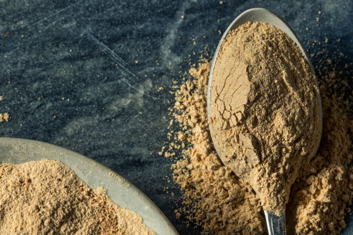 powdered maca root on spoon