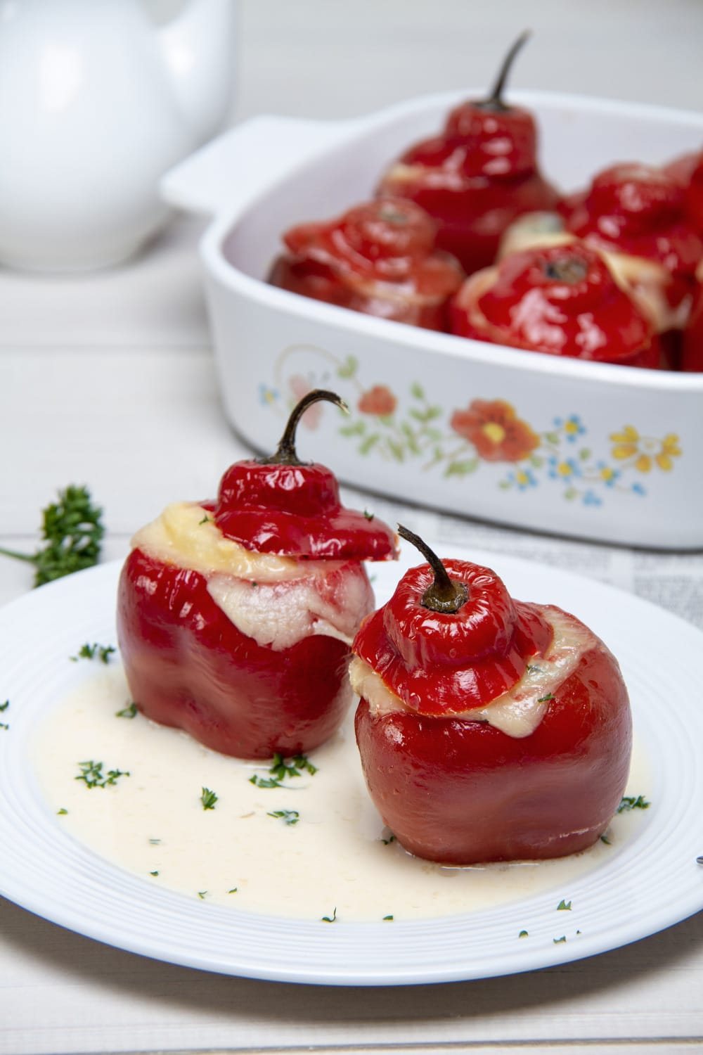 Stuffed Red Peppers On Plate With Evaporated Milk Sauce
