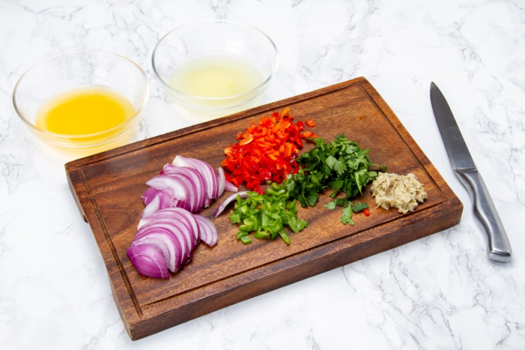 step 5 cut onions peppers cilantro ginger on chopping board