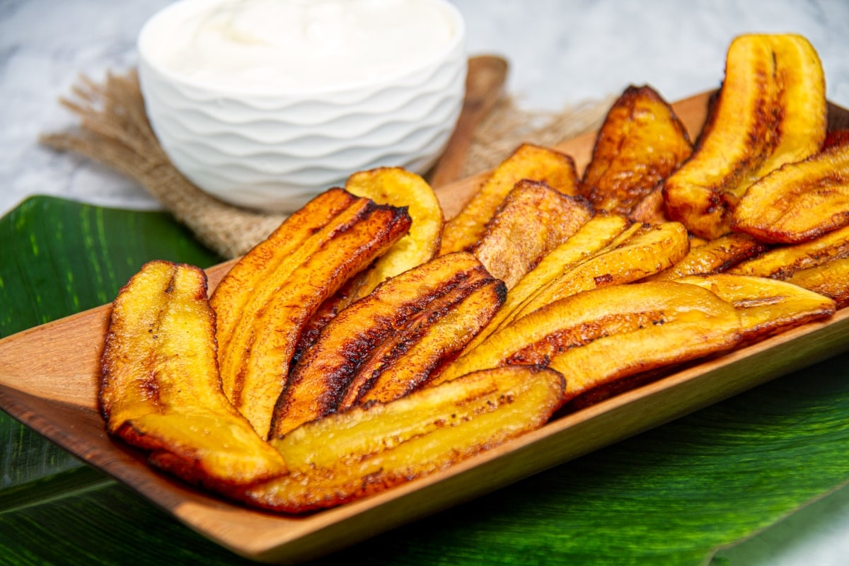 plate of of ripe platanos fritos peruvian dish with dipping sauce