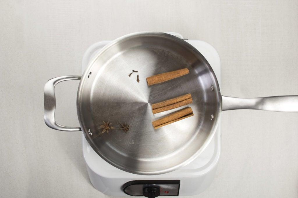step 2 heat cinnamon cloces star anise on pan