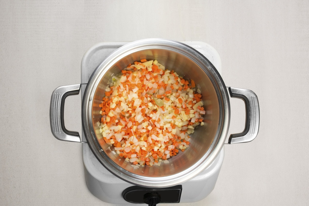 step 4 add potatoes and carrots to sauteed onions