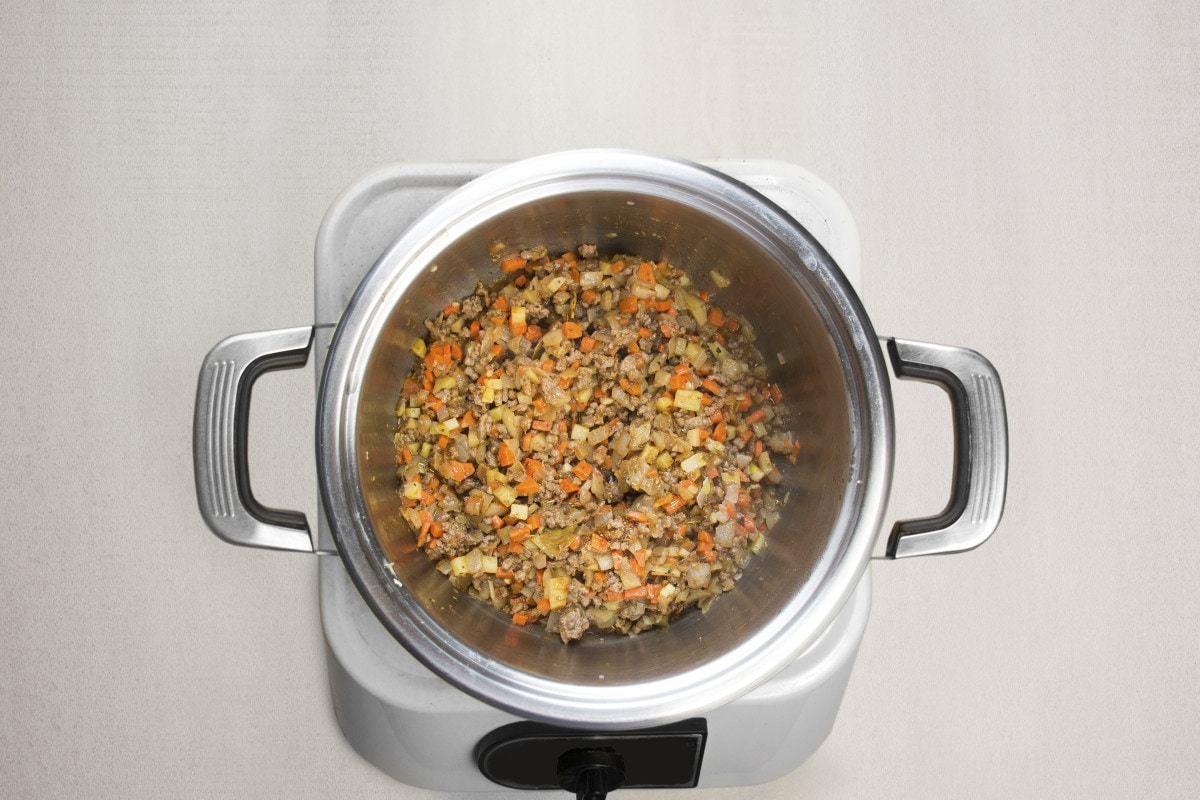 step 5 add beef and oregano to simmer in pot